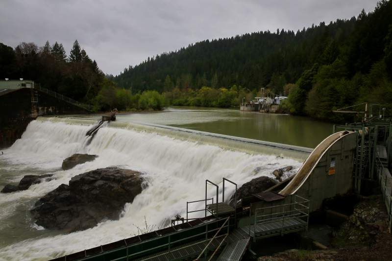 Water from the Eel River collects at the Van Arsdale Reservoir and flows over the Cape Horn Dam. A percentage of the water is redirected through a diversion tunnel, at the building in the background, to the Potter Valley Powerhouse and the east fork of the Russian River. (CHRISTOPHER CHUNG / The Press Democrat)
